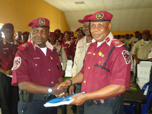 Mr. Jonas Agwu (left), former Sector Commander, Lagos State handing over to the new Lagos Commander, Mr. Nseobong Akpabio in Lagos recently.