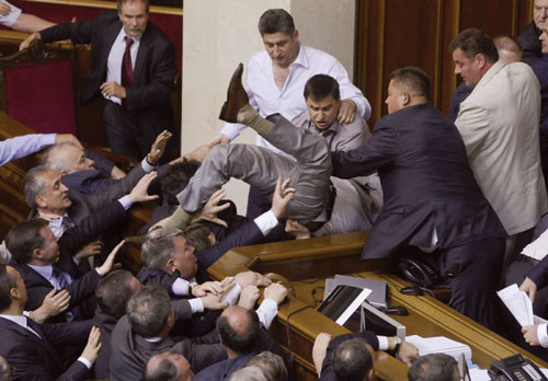 Like Nigeria, Like Ukraine: Parliamentatrians in Ukraine fighting on the floor of the parliament this afternoon. PHOTO: AP.