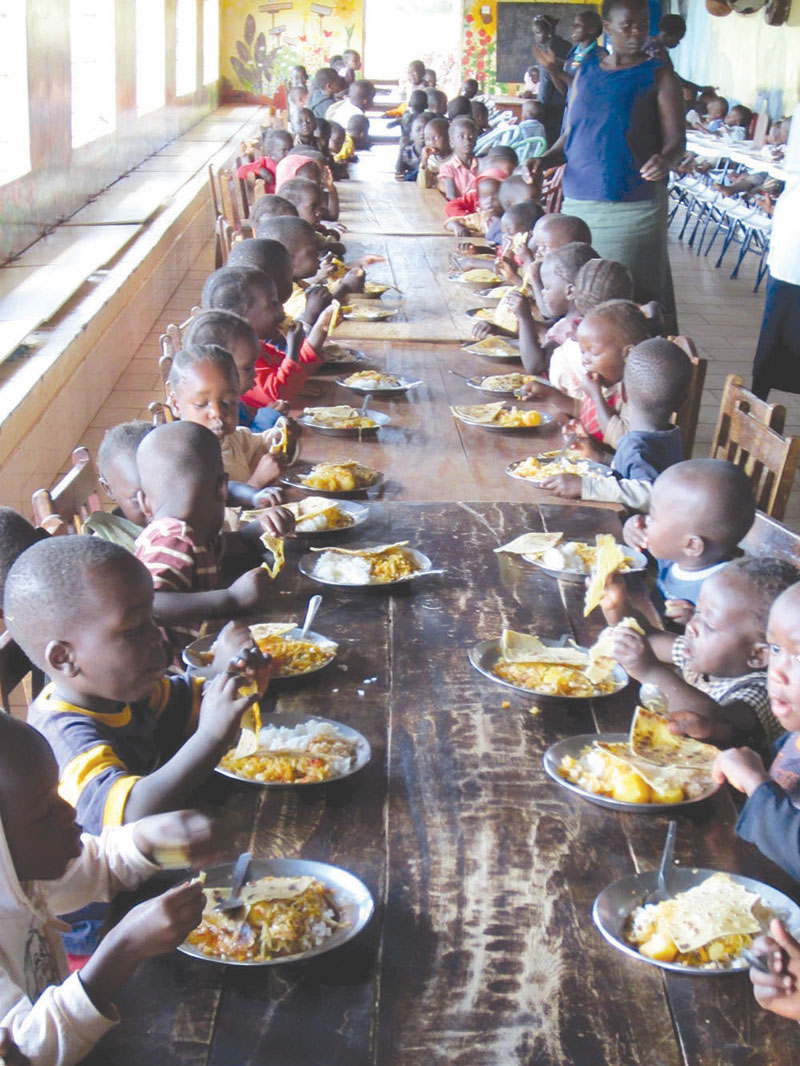 Abandoned children in an orphanage having their meal.
