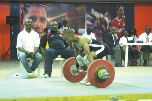 •A weight lifter during a weightlifting tourney.