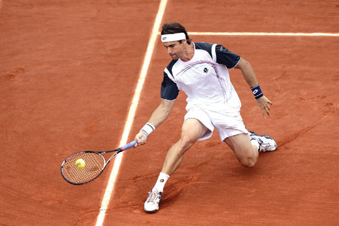 RETURN… Spain's David Ferrer hits a return to British's Andy Murray during their men's quarter final tennis match of the French Open tennis tournament at the roland Garros stadium yesterday. Photo: AFP.