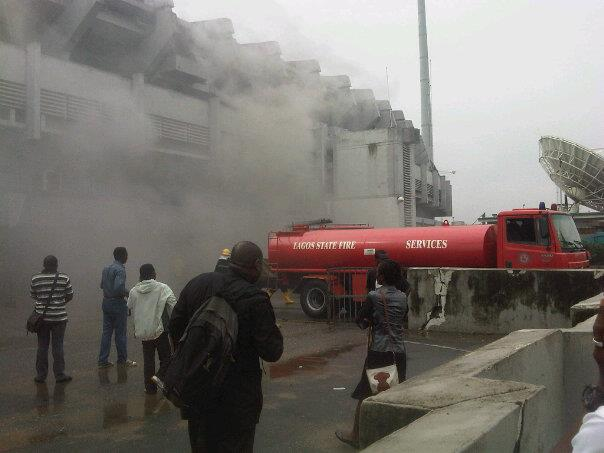 Fire fighters at the scene of the fire incident at the National Stadium in Lagos today