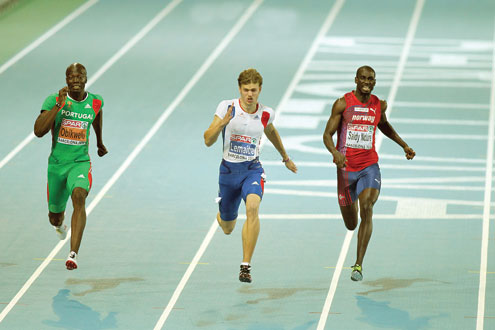 Nigerian born Francis Obikwelu of Portugal (l) in action during a recent athletics meet.