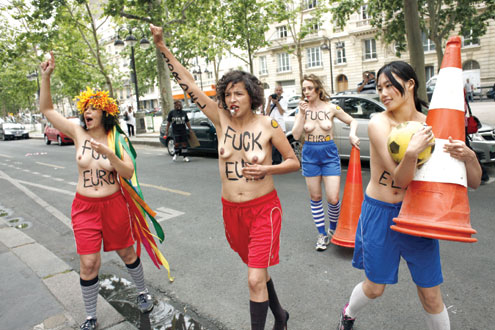 •ALL FOR WOMEN…French members of Ukrainian feminist group 'Femen' protest against prostitution during the Euro 2012 football championships in front of the Ukrainian Embassy in Paris on 1 June, 2012. The protest was held to oppose the staging of the Euro 2012 in Ukraine a week ahead of the event. AFP PHOTO