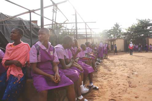 Student of Ikosi Junior High school sitting outside their classrooms today following the strike by their teachers. Photo: Emmanuel Osodi