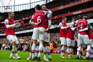 Arsenal players celebrate third goal