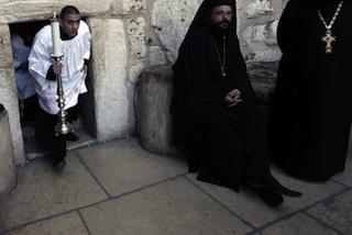 An altar boy walks through the door of Nativity in Bethlehem