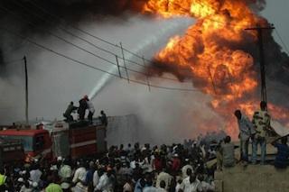 firemen battle an oil pipeline fire in Lagos