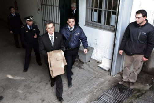 Vassilis Papageorgopoulos, left being escorted to prison