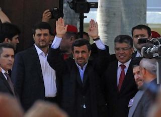Iranian President Mahmoud Ahmadinejad  waving at the funeral. AFP