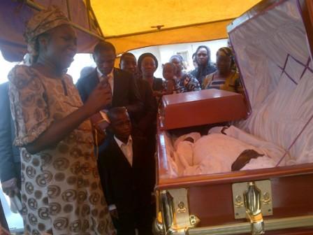 •Cecilia Adedeji, her kids and other mourners at the burial of Ademola Adedeji today at Mowe. PHOTO: SIMON ATEBA.