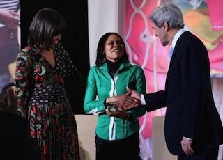 Joe Odumakin being congratulated by John kerry and Michele Obama