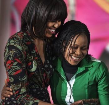Bonding: Michele Obama and Joe Odumakin. AFP Photo