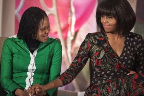 Michele Obama congratulates Joe Odumakin after receiving the award