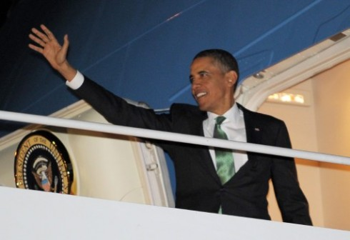 Obama: aboard Air Force One. AFP Photo