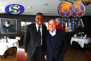 Oliseh, left, with FIFA president Sepp Blatter at a recent funstion