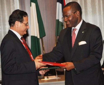 MINISTER OF FOREIGN AFFAIRS, AMB OLUGBENGA ASHIRU (R) EXCHANGING SIGNED DOCUMENT WITH THE LEBANESE FOREIGN MINISTER, MR ADNAN MANSOUR AT A BILATERAL MEETING BETWEEN THE TWO COUNTRIES DURING THE VISIT OF LEBANESE PRESIDENT MICHEL SLEIMAN IN ABUJA ON MONDAY