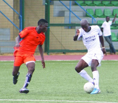 •Baruwa Tunde of Messiah FC (right) tries to dribble Badru Azeez of Christ Ambassadors FC during their first match of the Lagos FA Cup played at the Agege Stadium 10 April, 2013. Messiah FC won 3-2. PHOTO: Emmanuel Osodi.
