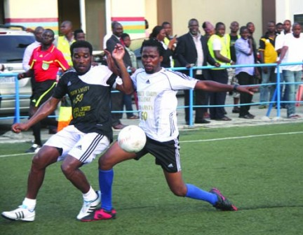 •Former Eagles' captain,  Austin Okocha (left) fights for the ball with one of the showbiz  players during a match to celebrate Fred Amata's birthday at Campus Square, Lagos Island, yesterday.  Inset is Amata with the MVP  award after the match.  Photo:  Emmanuel Osodi.