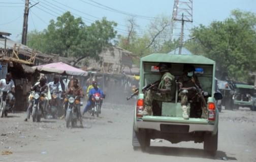 File photo: soldiers on patrol in Maiduguri.: emergency rule has not stemmed Boko Haram attacks. AFP