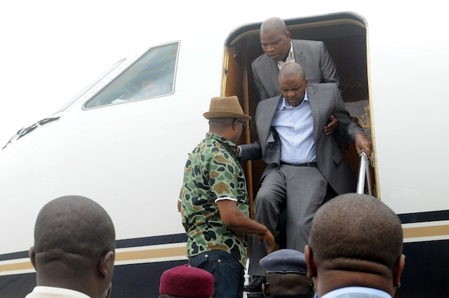 Governor Suntai being helped to disembark in Abuja