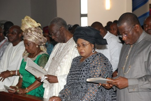 Dame Patience Jonathan so engrossed in her own world in this photo inside the church