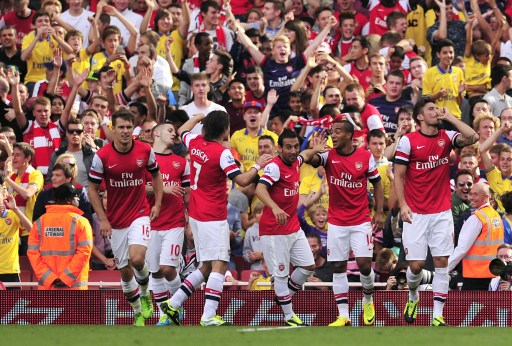 Arsenal players celebrate goal