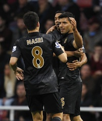 Aguero, right with Nasri and another player in celebration