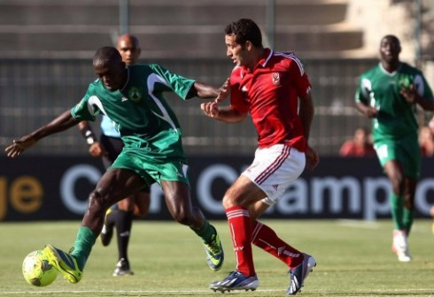 Egypt's footballer Mohamed Abou Trika (R) of al-Ahly vies for the ball against Cameroon's Moussa Souleymanou of Coton Sport during their African Champions League semi-final football match at El-Gouna stadium in Hurghada on October 20, 2013. The match ended in sa 1-1 draw. AFP
