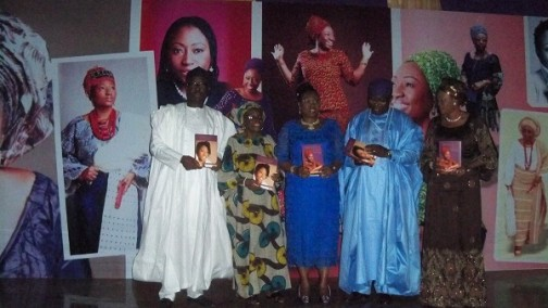 Erelu Bisi and her husband, Dr. Kayode Fayemi supported by others to display the launched books