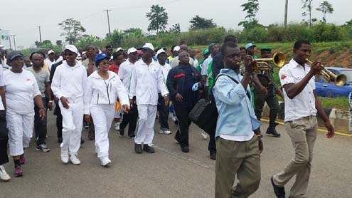 Governor, State of Osun, Ogbeni Rauf Aregbesola (middle); his Deputy, Mrs Titi Laoye-Tomori ( in blue cap); Chief Judge of the State, Justice Oyebola  Ojo (3rd left); Attorney General/Commissioner for Justice, Hon.Wale Afolabi (4th left) and others, during a road walk as part of activities, marking 2013 Legal Year, in Osogbo, State of Osun on Friday 18-10-2013