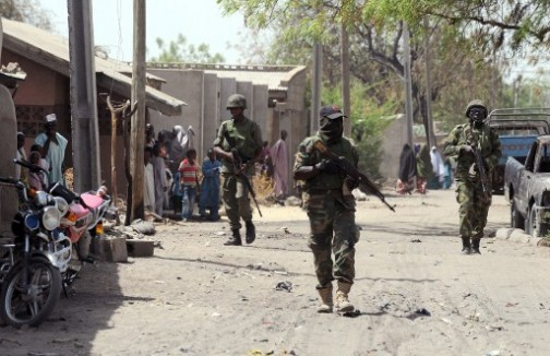 Nigerian soldiers on patrol in a northern town