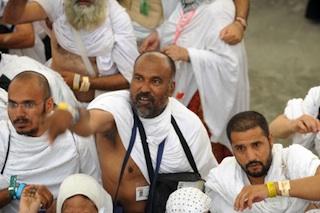 "Muslim pilgrims throw pebbles at pillars during the ""Jamarat"" ritual"