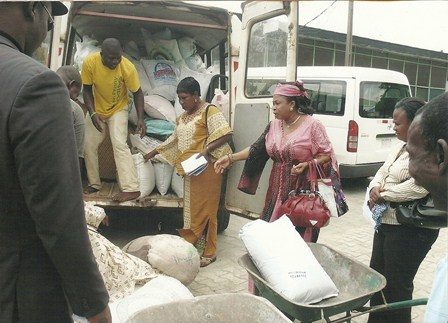 Christy Igbokwe giving out food items to charity