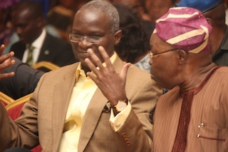 Fashola with the chairman of the Lagos State Security Fund