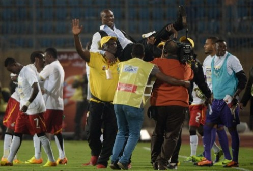 Ghana's head coach James Kwesi Appiah (above) celebrates with his team their victory over Egypt in Cairo