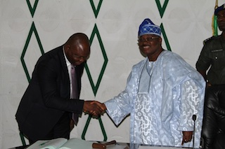 Governor Abiola Ajimobi  congratulating his SA on media, Dr. Festus Adedayo on his reappointment