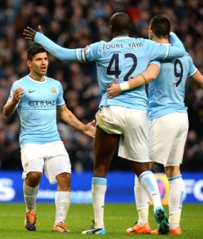 Manchester City's Argentinian forward Sergio Aguero (L) celebrates after scoring the fourth goal during the English Premier League football match between Manchester City and Tottenham Hotspur. AFP