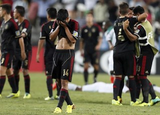 Mexico player Aguirre (14) who scored own goal, walks off the pitch after loosing to Nigeria in the finals of the FIFA U-17 World Cup 2013 football match at the Mohammed bin Zayed Stadium, on November 8, 2013, in Abu Dhabi.