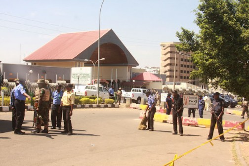 Barred: Policemen and soldiers barricade  the INEC Headquarters gate