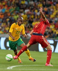South African striker goes for the ball agsinst Spain