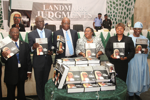 L-R: Lagos State commissioner for Justice and Attoney General, Mr. Ade Ipaye,  Justice George Oguntade (rtd), Chief Judge of Lagos State, Justice Ayotunde Phillips and Lagos State Deputy Governor, Mrs. Adejoke Orelope-Adefurile during the launching of a book titled ' Landmark Judgment' written by Velma Publishers in honour of Chief Judge of Lagos State, Justice Ayotunde Phillips held at City Hall, Lagos Island today. PHOTOS: EMMANUEL OSODI
