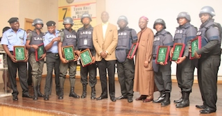 Fashola, middle, with the police officers honoured for gallantry