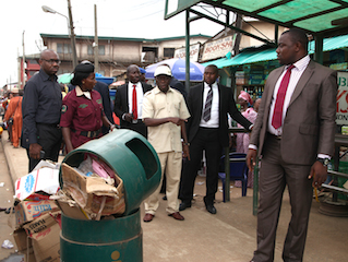 oshiomhole unhappy with refuse dumped on Mission road