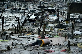 A body of a dead man is seen in Tacloban, on the eastern island of Leyte