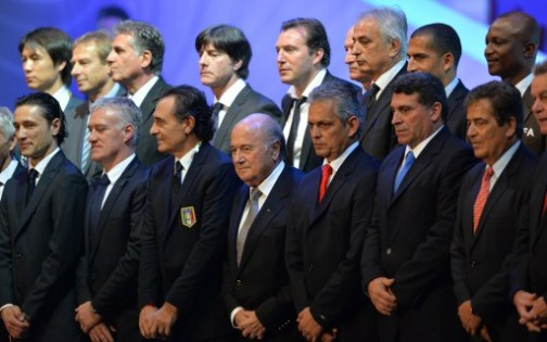 FIFA President Joseph Blatter (C) poses with the coaches of the national teams taking part in the Brazil 2014 FIFA World Cup, during the groups-stage draw, in Costa do Sauipe, Bahia state, Brazil,