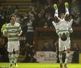 Efe Ambrose head over heelsafter Celtic goal