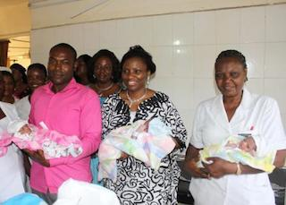 Judith Amaechi, m, with one of the triplets