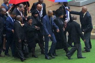 Mandela's former wife Winnie Mandela (3R) arrives for the memorial service