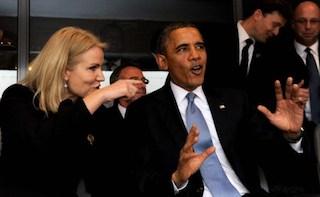 Danish Prime Minister Helle Thorning-Schmidt (L) talks with US President Barack Obama